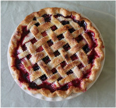 A whole cherry pie, dripping with juice and history