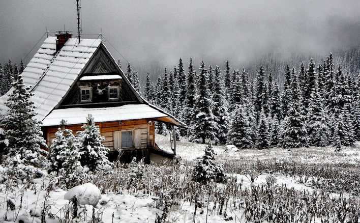 Picture of cabin on mountain in snow