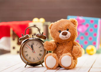 Picture of alarm clock and teddy bear